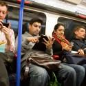 people reading smartphone on train